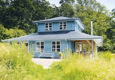 West side story: blue guest-house overlooking the Isle of Mull