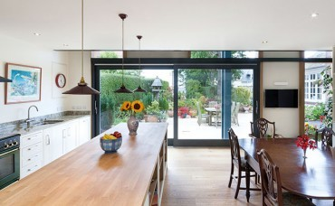 Arts and Crafts coach house gets a modern makeover