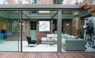 Trombé Architecture used extensive glazing to update a red-brick property