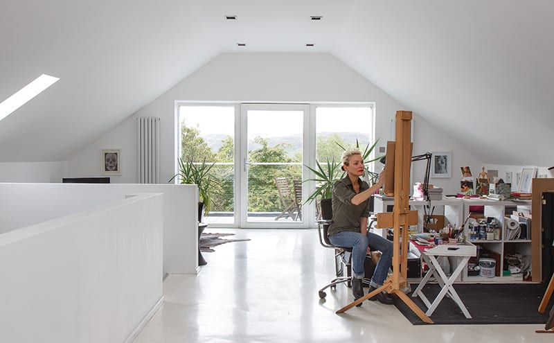 Heather in her upstairs studio which has a high gloss resin floor by Kasra Chem and radiators by Milano Aruba
