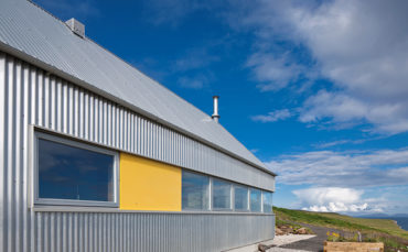 Behind its striking aluminium cladding is a beautifully simple house that pays homage to its rural setting