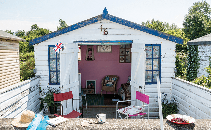 The weathered tongue-and-groove is immediately evocative of the seaside. A leftover tin of pink paint came in handy for the interior