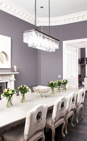 Zoffany grey walls keep the dining room formal but soft and allow the Murano glass light to be the focus. [