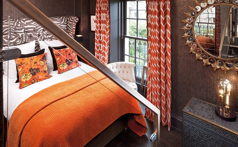Animal prints and orange tones give the guest room a playful feel.