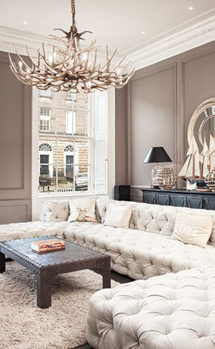 The 'Restoration Hardware room' has an NY loft aesthetic, with space for lots of friends on the Savoy sofa