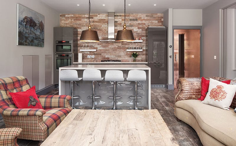 The living area in the basement is relaxed and uncomplicated with earthy tones and Moon fabric tartan accents