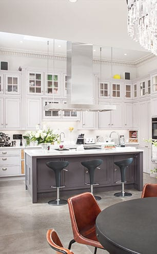 Custom-made cabinetry by Studio Carpentry is painted in Little Greene's Dash of Soot and Knightsbridge colours.