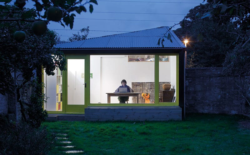 Under a roof made of corrugated metal, the studio is a clean, bright space for creative projects