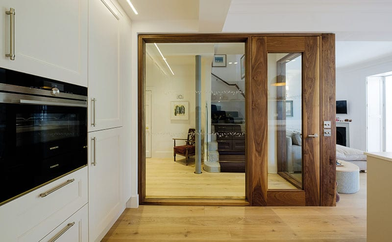 Architect Nigel Somner designed the rich walnut door and screen to allow as much light as possible through to the staircase leading to the upper floors