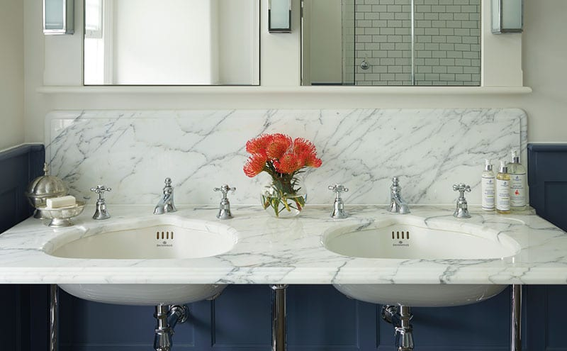 A slab of Arabescato marble tops the vanity unit