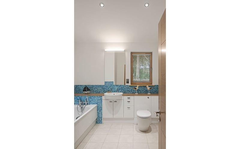 The bathroom has Ideal Standard sanitaryware and tiles from Collinson Ceramics.