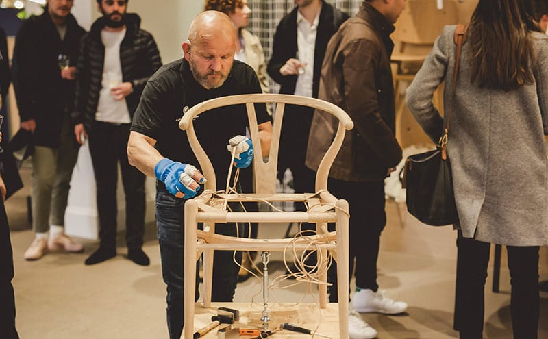 Master weaver Benny Larsen was hard at work on the Wishbone chair seat
