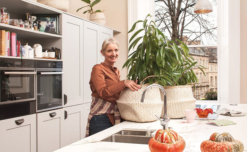 The family's kitchen is open plan and double aspect, giving her sculptural plants plenty of natural light