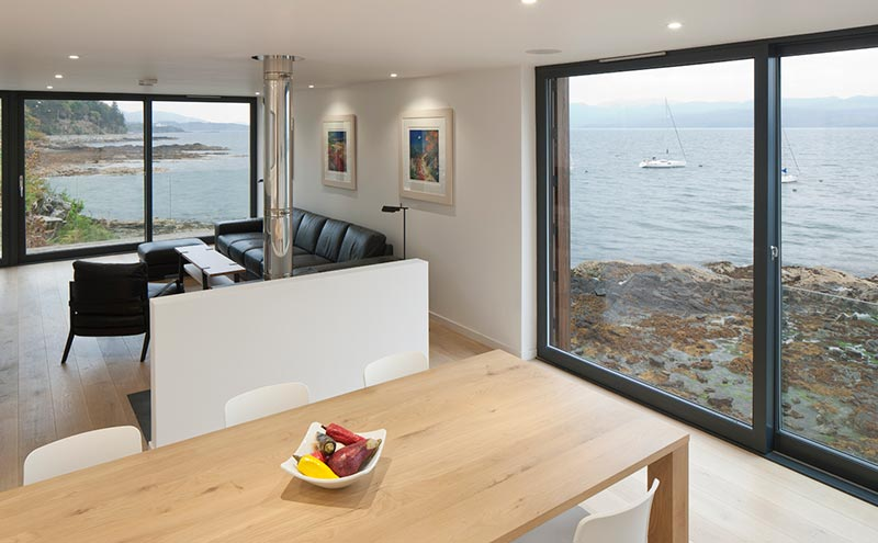 The open-plan living and dining area with its double-aspect sea views