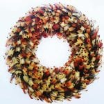 Cock pheasant orange feather wreath, £65, Plucking Fabulous