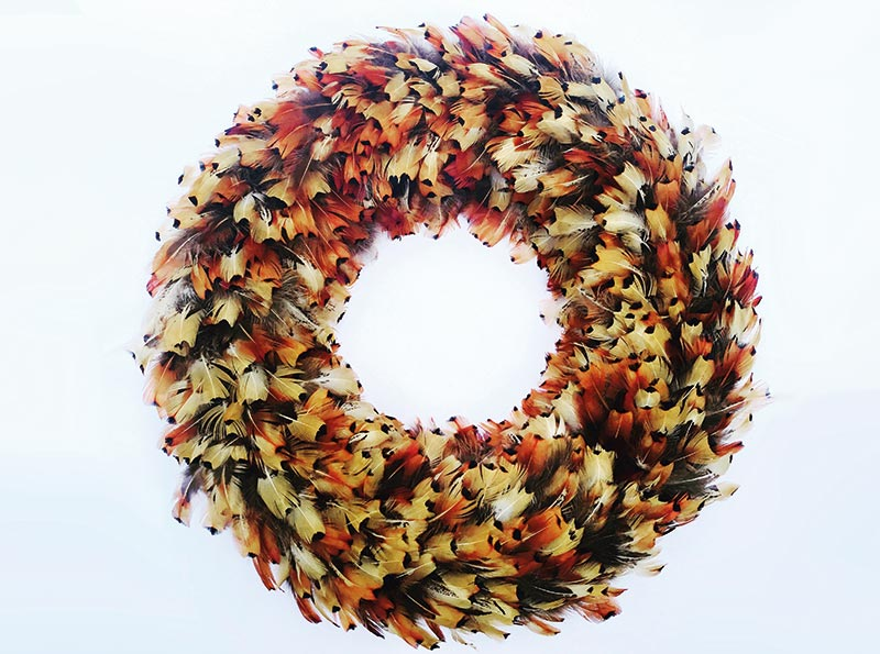 Cock pheasant orange feather wreath, £65, Plucking Fabulous