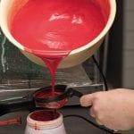 refilling the spray gun with coloured cocoa butter