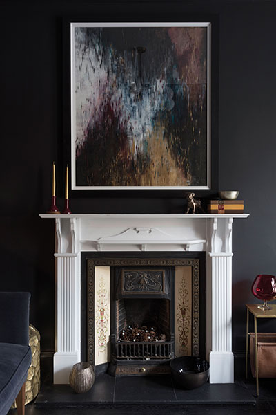 A painting by Helen Stevens hangs above the fireplace which was original to the flat