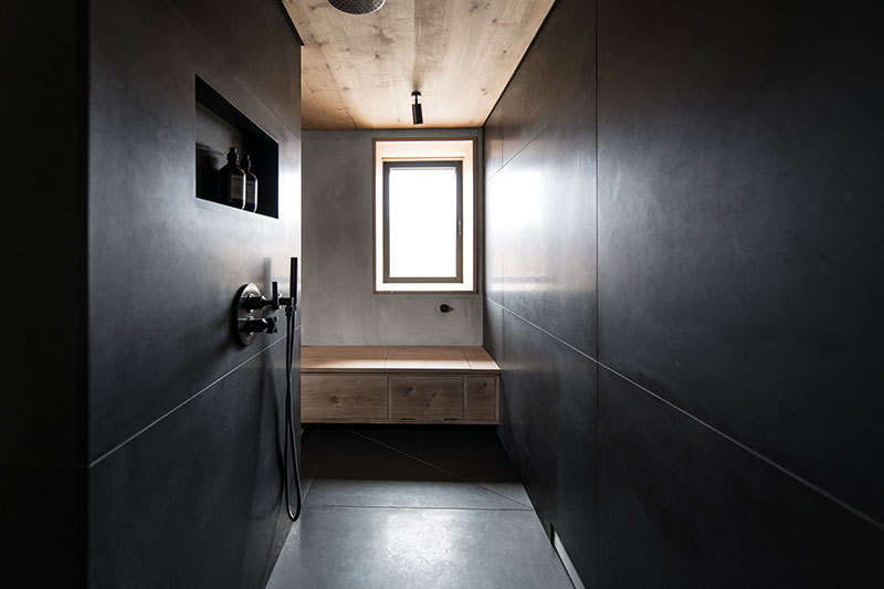 The moody walk-in shower is designed to calm the senses