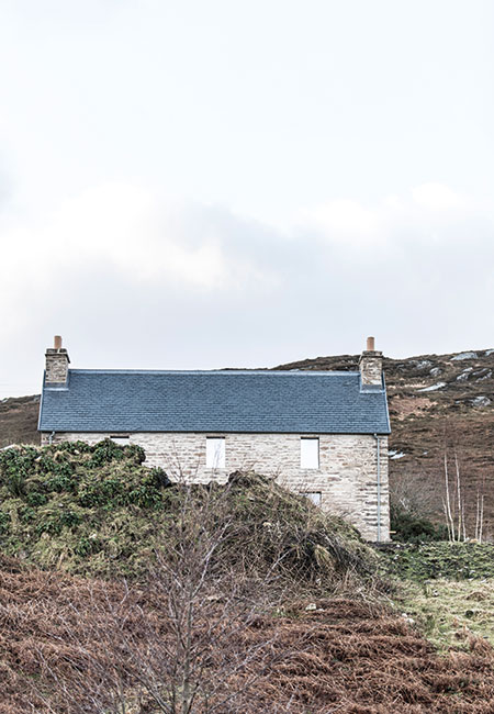 The beautifully symmetrical Kyle House, with its new roof of local slate