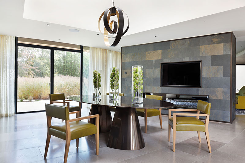 dining room with bronze resin Davidson dining table, with oak chairs