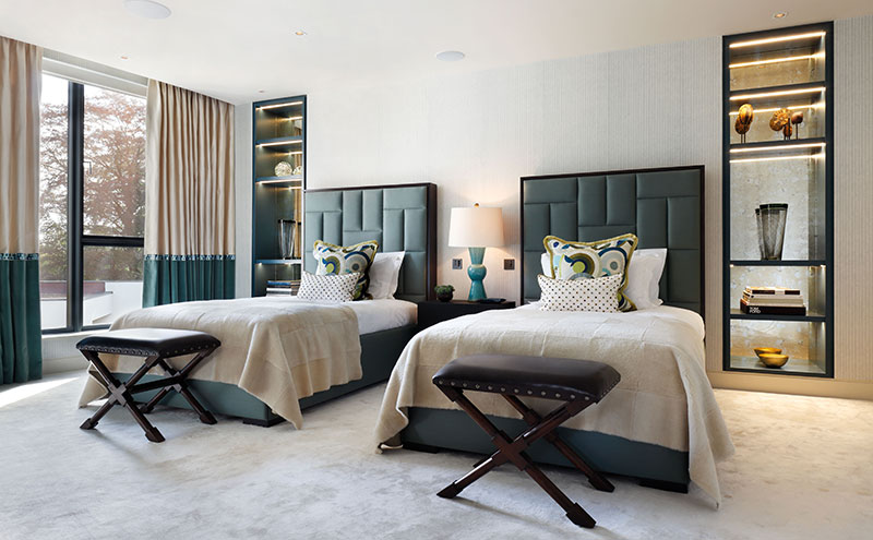 The built-in glass shelving in this sophisticated guestroom is removable