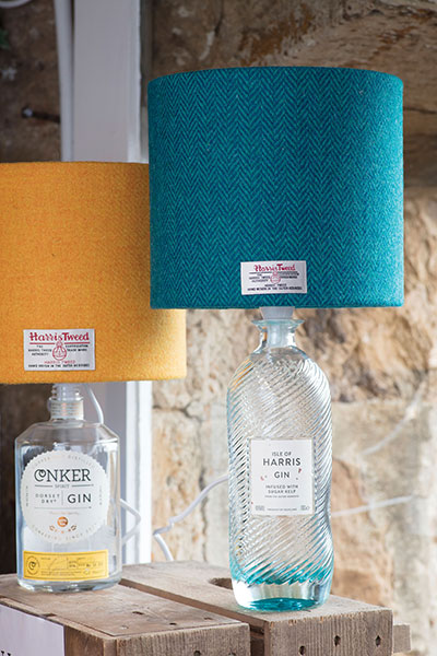 Recycled gin bottles are now table lights by Tara Pollock