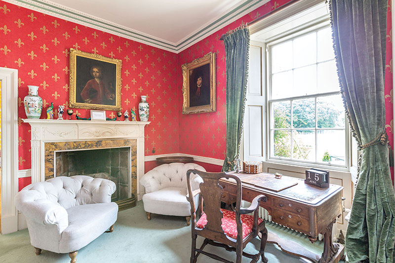 This regal room, like many in the house, has been furnished with antiques from Wardhill's past