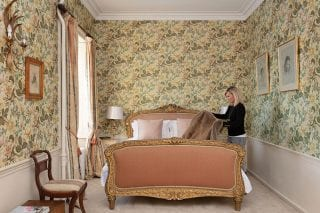 Sarah preparing the Spanish Room for guests. The gilded bed was a gift from the Queen of Spain to Will's great-great-great-grandmother, who was her lady-in-waiting