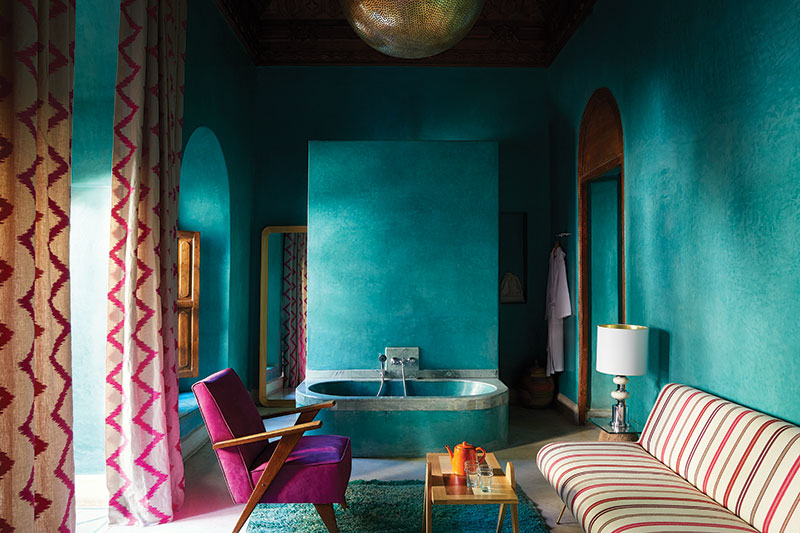 The intense teal pigment in the tadelakt-finished walls echoes the rich jewel tones that Marrakech is famous for. The bath has been hand-finished with silver accents and the vintage flea-market furniture has been covered in locally made kilim rugs and Berber blankets. Light fittings have been made in the nearby souks