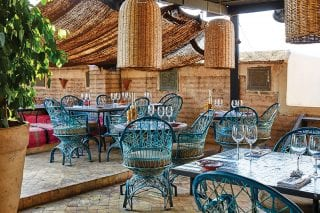 Food and drink are a big part of the atmosphere at El Fenn, and the roof terrace is a special spot for enjoying an afternoon mint tea or a cocktail at sundown. Authentic rattan and traditional tiles, lemon trees and colourful textiles add to the Moroccan ambience