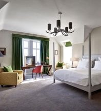 'Scandi-Scots' styling sees Osborne & Little curtains working in harmony with Character Joinery's bespoke bed frame and an Ian Sanderson armchair