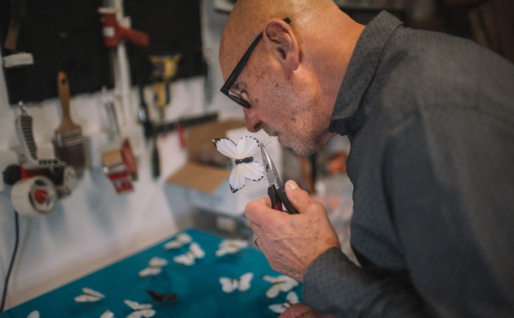 Michael Olsen making a butterfly artwork