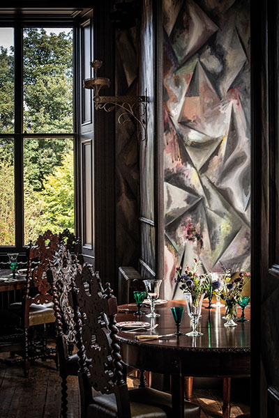 A mural by Argentina's Guillermo Kuitca in the Clunie dining room references the waters that run through the village
