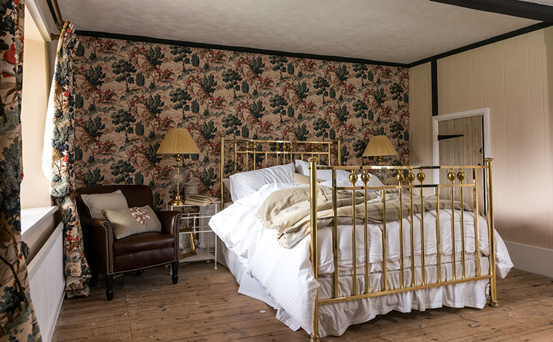 bed by Wrought Iron and Brass Bed Company set up in bedroom
