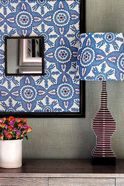 patterned-mirror-on-sideboard-with-matching-lamp
