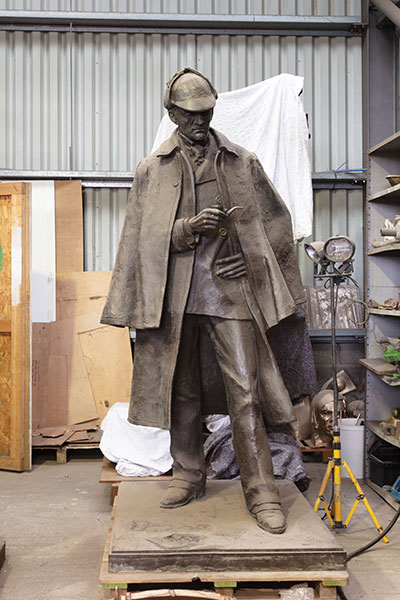 the-Sir-Arthur-Conan-Doyle-monument-(1990)-by-Gerald-Laing-in-storage-during-the-reconstruction-of-Picardy-Place-in-Edinburgh