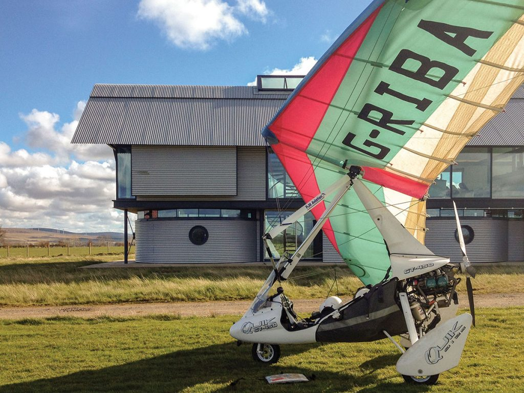 external-shot-of-house-with-microlight-in-front-of-it