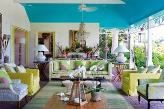 The-sitting-room-is-openA-mix-of-coral-inspired,-African-and-shell-covered-lamps-complement-Kit-Kemp's-Willow-fabric-for-Christopher-Farr-on-the-chairs