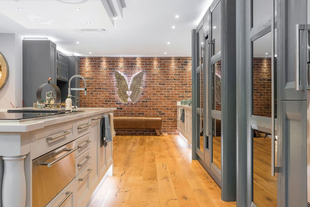 kitchen-with-angel-wings-on-brick-wall