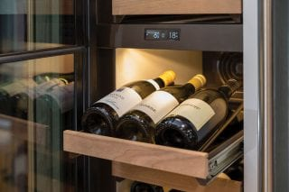 wine-cooler-with-bottles-of-white-wine