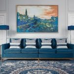 blue-sofa-with-painting-above-it