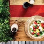 red-strip-table-with-salad-on-it