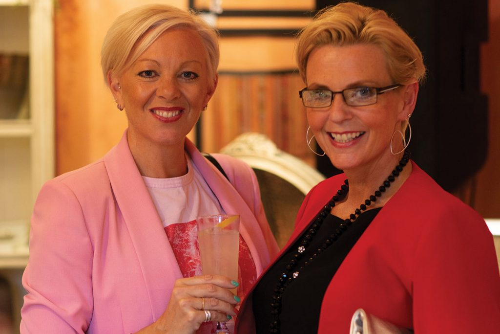 women-in-pink-suit-and-women-in-red-jacket