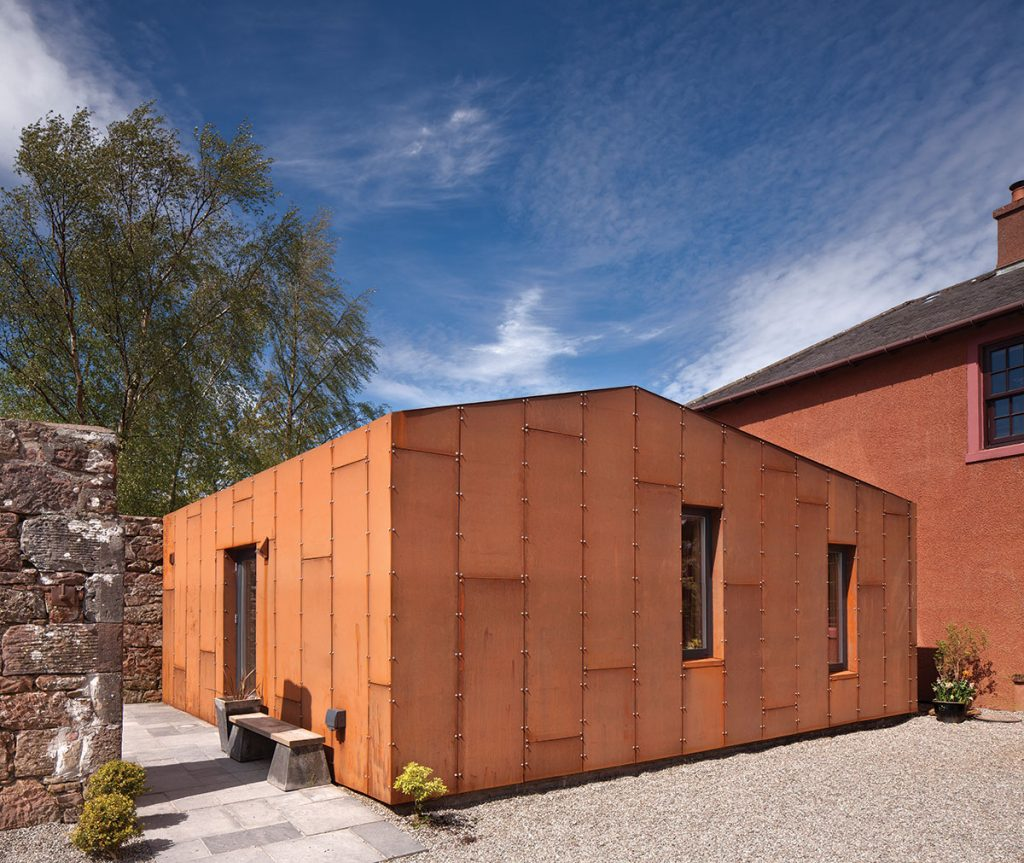 terracotta coloured extension against blue sky