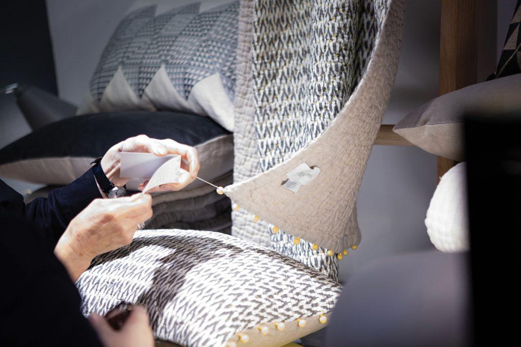 Close-up-of-an-Ikat-throw-and-cushion