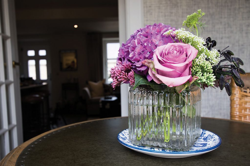 bunch-of-pink-and-green-flowers-on-table