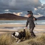 ian-lawson-walking-on-beach-in-the-hebrides-with-his-dog