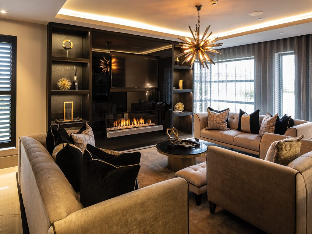 black-and-gold-living-room-with-fire