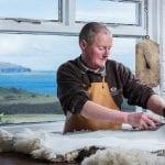 Pete-trims-the-sheepskin-with-a-sharp-blade